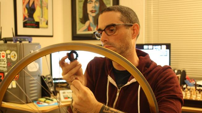 Josh_Sawyer_removing_spokes_from_a_bicycle_wheel