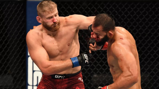 Polsko má nového šampiona v UFC! Jan Blachowicz knockoutoval Dominicka Reyese a vzal si šampionský pás