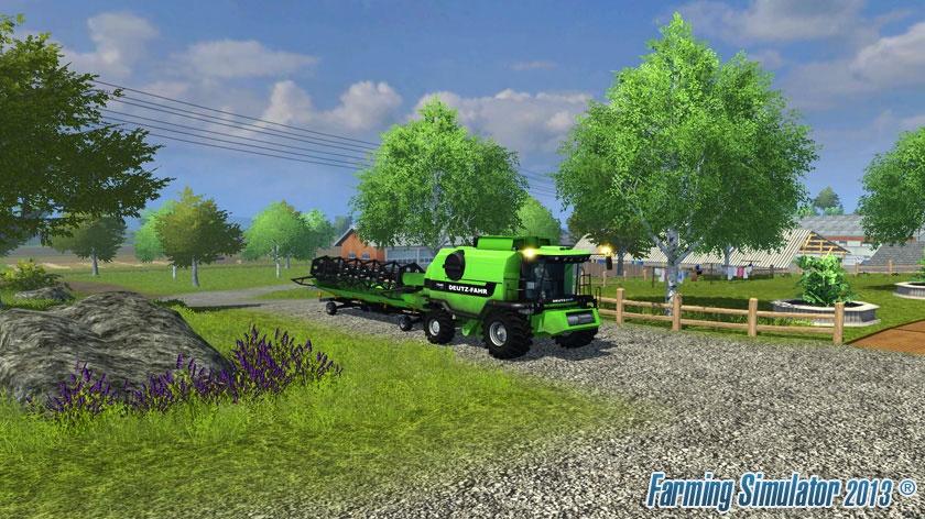 Traktory, lacláče a slepice v traileru na konzolový Farming Simulator