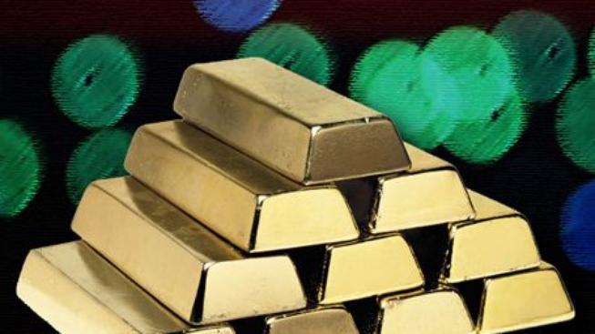 Cena zlata útočí na kótu 1000 USD