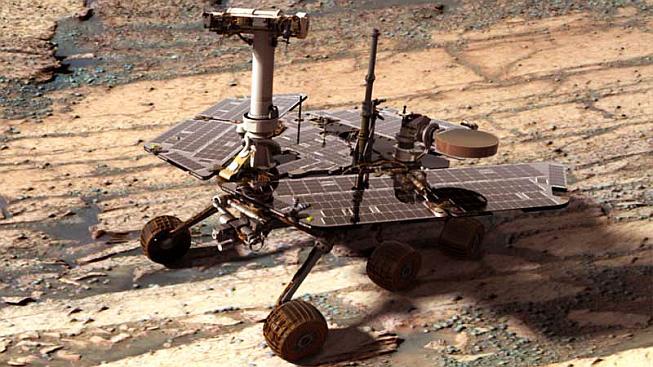 Složený snímek sondy Opportunity, digitálně dosazené do krajiny u kráteru Endurance