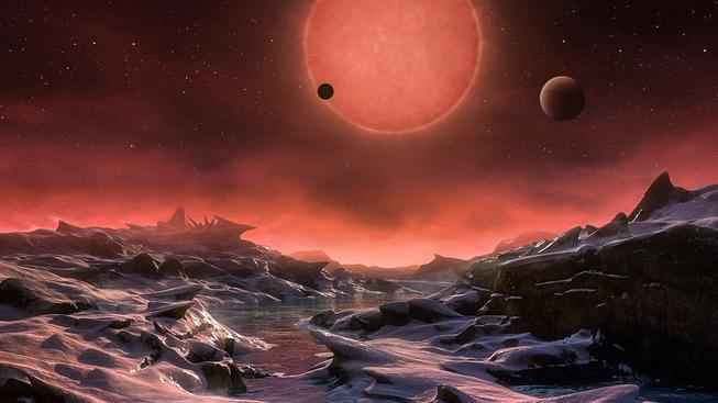 Představa pohledu na chladného trpaslíka TRAPPIST-1 z povrchu jedné z jeho planet