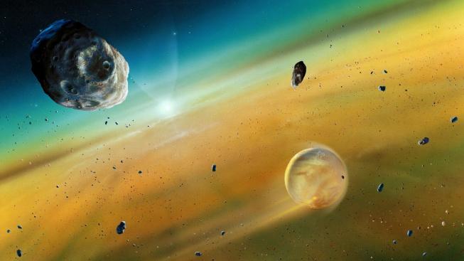 Umělecká fikce formování Země v rané sluneční soustavě z rotujícího disku materiálu, který se tvořil kolem Slunce před 4,6 miliardami let.