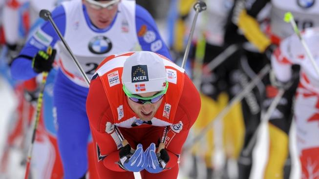 Image: 0111660677, License: Rights managed, The second placed Petter Northug (C) of Norway leads the pack in the men's Tour de Ski 15 kilometers pursuit competition on December 30, 2011 in Oberhof, eastern Germany.    AFP PHOTO / ROBERT MICHAEL, Place: GERMANY, Model Release: No or not aplicable, Credit line: Profimedia.cz, AFP