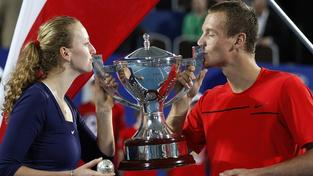 Tomas Berdych (R) and Petra Kvitova (L) of the Czech Republic celebrate clutching diamond encrusted tennis balls and kissing the Hopman Cup after defeating Richard Gasquet and Marion Bartoli of France in the final of the Hopman Cup Tennis Tournament in Perth on January 7, 2012. The Czech Republic team won their respective matches. IMAGE STRICTLY RESTRICTED TO EDITORIAL USE-STRICTLY NO COMMERCIAL USE AFP PHOTO/Tony ASHBY (Photo credit should read TONY ASHBY/AFP/Getty Images)