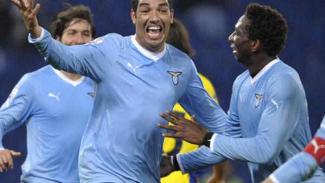 Lazio Brazilian defender Andre Dias, center, celebrates after scoring during an Italian Cup soccer match between Lazio and Verona, at Rome's Olympic stadium Tuesday, Jan. 10, 2012. (AP Photo/Alfredo Falcone, Lapresse)