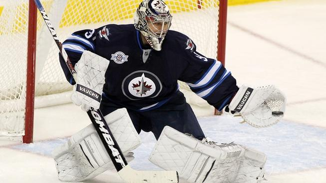 WINNIPEG, CANADA - JANUARY 12: Ondrej Pavelec #31 of the Winnipeg Jets blocks a shot on goal in a game against the San Jose Sharks in NHL action at the MTS Centre on January 12, 2012 in Winnipeg, Manitoba, Canada. (Photo by Marianne Helm/Getty Images)