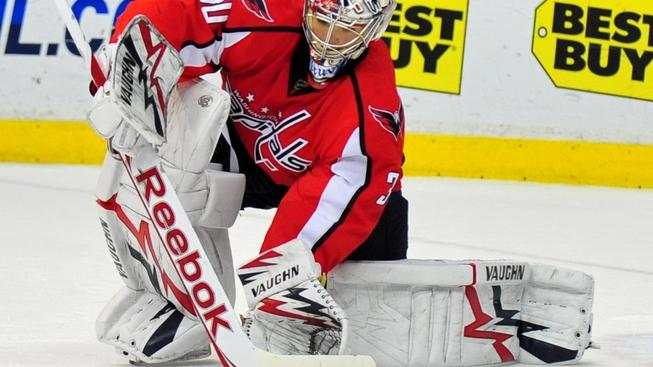 Washington Capitals' goalie Michal Neuvirth makes a save against Ottawa Senators during the second period at the Verizon Center in Washington on January 16, 2011.  UPI/Kevin Dietsch