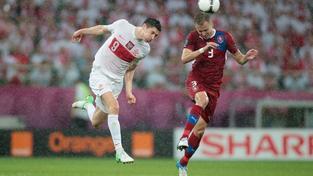 Na Městském stadionu v polské Wroclawi se 16. června 2012 odehrál poslední zápas české reprezentace ve skupině A proti celku Polska. Na snímku (vlevo) a  (vpravo) MILAN KAMMERMAYER / MEDIAFAX