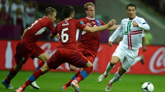 Image: 0133247684, License: Rights managed, Restrictions: RESTRICTED TO EDITORIAL USE, Portuguese forward Cristiano Ronaldo (R) vies with Czech defender Michal Kadlec (L), Czech defender David Limbersky (C) and Czech defender Tomas Sivok during the Euro 2012 football championships quarter-final match the Czech Republic vs Portugal on June 21, 2012 at the National Stadium in Warsaw., Place: POLAND, Model Release: No or not aplicable, Credit line: Profimedia.cz, AFP