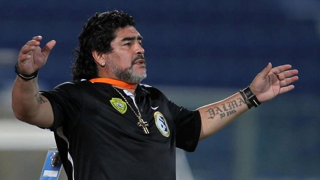 Image: 0130579082, License: Rights managed, Argentine football legend Diego Maradona, coach of UAE's Al-Wasl, reacts during his team's GCC Champions League football match against Qatar's Al-Khor in Doha on May 30, 2012. AFP PHOTO/KARIM JAAFAR, Place: QATAR, Model Release: No or not aplicable, Credit line: Profimedia.cz, AFP