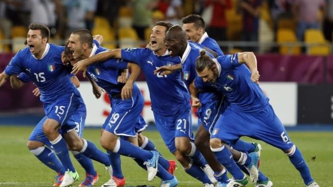 Italian players celebrate after winning the penalty shootout during the Euro 2012 soccer championship quarterfinal match between England and Italy in Kiev, Ukraine, Monday, June 25, 2012. (AP Photo/Kirsty Wigglesworth)