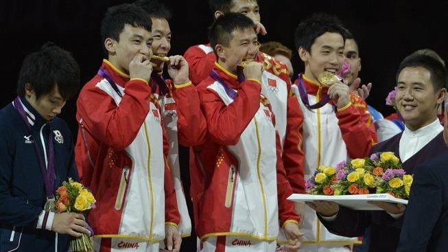 Image: 0138983166, License: Rights managed, Restrictions: * Los Angeles Times and U.S. Tabloid Rights OUT *, July 30, 2012 - London, England, United Kingdom - The members of China's men's gymnastics team bite their gold medals in a traditional gesture that tests to see if they are real gold.  The team won gold in the Gymnastic team final Monday night, Place: United Kingdom, Model Release: No or not aplicable, Credit line: Profimedia.cz, Zuma Press - News