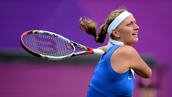 Image: 0138880327, License: Rights managed, Czech Republic's Petra Kvitova returns to Ukranie's Kateryna Bondarenko during their London 2012 Olympic Games women's singles tennis match at the All England Tennis Club in Wimbledon, southwest London, on July 28, 2012. AFP PHOTO/ Martin Bernetti, Place: UNITED KINGDOM, Model Release: No or not aplicable, Credit line: Profimedia.cz, AFP