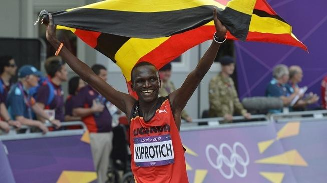 Image: 0139656913, License: Rights managed, Stephen Kiprotich of Uganda celebrates after winning the Men's Marathon at the London 2012 Summer Olympics on August 12, 2012 in Westminster, London. Kiprotich took the Gold Medal with a time of 2:08:01 in the race., Place: ENGLAND, Model Release: No or not aplicable, Credit line: Profimedia.cz, UPI