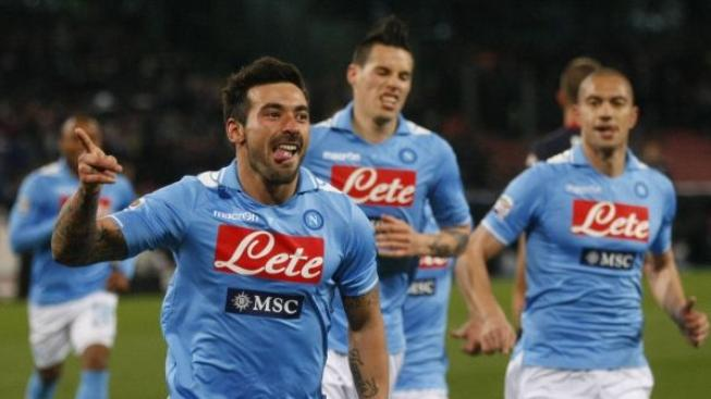 Napoli's Argentinian Forward Ezequiel Lavezzi celebrates after scoring during the Italian serie A football match between SSC Napoli and Cagliari Calcio at the San Paolo Stadium on March 9, 2012 in Naples. AFP PHOTO / CARLO HERMANN
