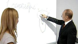 Putin kreslí na tabuli
