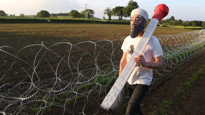 Muž v masce bin Ládina, ilustrační snímek