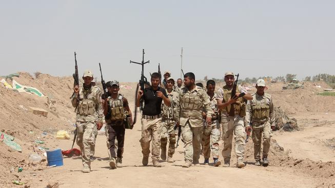 Iráčtí dobrovolníci, kteří se přidali k šiitům v boji proti sunnitům