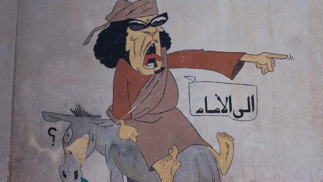 Pouliční karikatura libyjského vůdce Kaddáfího v Tripolisu