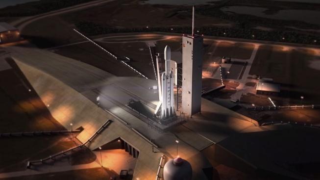 Snímek z animace startu a letu rakety Falcon Heavy