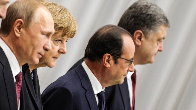 Normandská čtyřka - prezidenti Ruska, Francie a Ukrajiny a německá kancléřka v Minsku