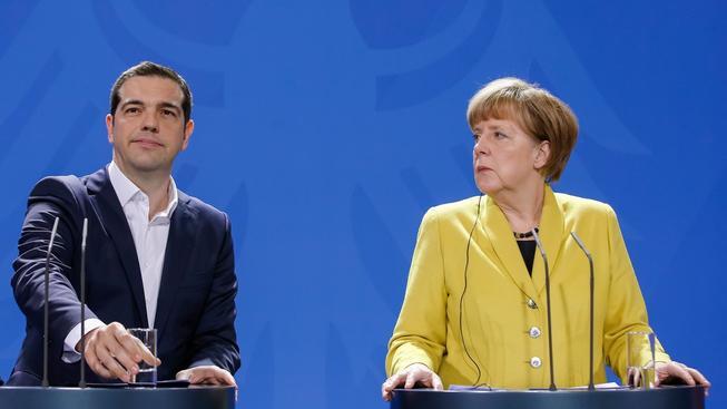 Řecký premiér Tsipras a německá kancléřka Merkelová, která chce udělat vše pro udržení Řecka v eurozóně