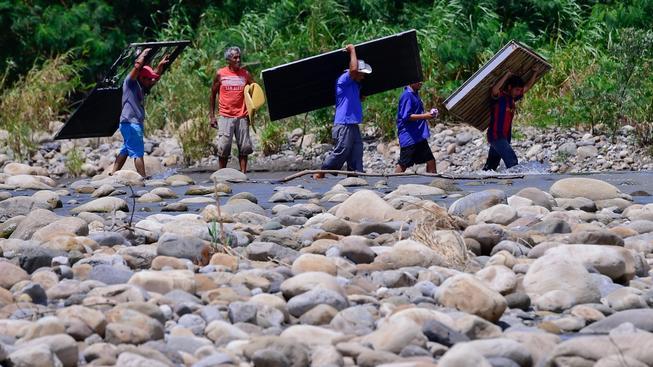 Kolumbijští uprchlíci se vracejí zpět domů z Venezuely