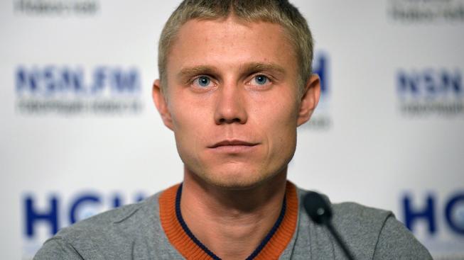 Ruský vytrvalec Viktor Ugarov během tiskové konference