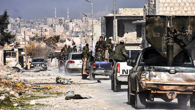 Provládní jednotky v dobyté čtvrti Šejcha Saída