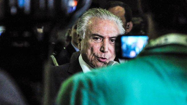 Brazilský prezident Michael Temer čelí podezření z korupce. K soudu ale nepůjde