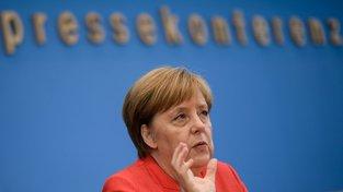 Angela Merkelová během letní tiskové konference