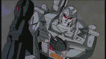 Transformers Unicron (Orson Welles) se setkává s Megatronem (Frank Welker)